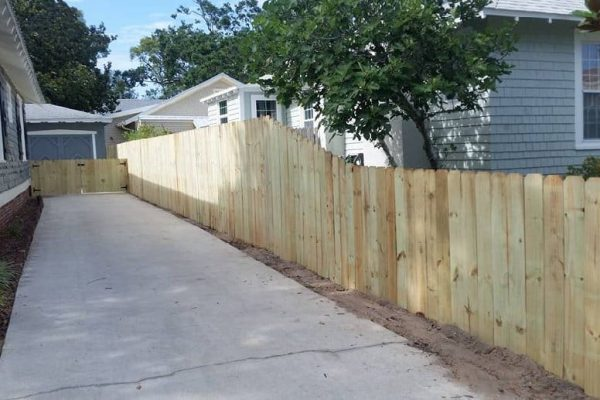 Tappered Wood Stockade Privacy Fence With Double Drive Gate